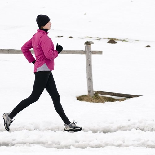 Compression pants keep you warm and dry for winter running outdoors.