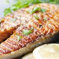 Herb grilled salmon is a great dinner option that's inexpensive and packed with protein.